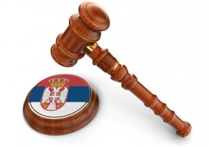 Wooden Mallet and Serbian flag (clipping path included)